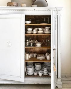 Love this kitchen cupboard full of white crockery and glasses via Antique Kitchen Cabinets, Rustic Cabinets, Kitchen Cupboards, Kitchen Furniture, Diy Kitchen, Kitchen Interior, Cool Furniture, Painted Furniture, Kitchen Ideas