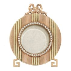 Faberge Yellow and Rose Gold Miniature Picture Frame. A Fabergé yellow and rose gold miniature picture frame with pearl decoration and ribbon bow top, workmaster Michael Perchin, St Petersburg, circa Selling Jewelry, Jewelry Shop, Fine Jewelry, Small Picture Frames, Antique Frames, Vintage Mirrors, Vintage Frames, Pearl Decorations, Faberge Eggs