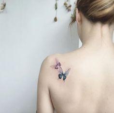 Butterflies on back shoulder by Tattooist Flower