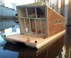 The Schwimmhaus by German architects Confused-Direction is a green house boat designed to float around or just stay put on the shore. Schwimmhaus is being built from wood salvaged from an old farm house in addition to other sustainable building materials. Bungalow, Sustainable Building Materials, Sustainable Houses, Sustainable Design, Sustainable Living, Floating House, Floating Boat, Unusual Homes, Boat Design
