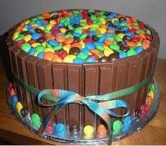 just bake and frost a cake, then surround it with kit-kats and top with m&ms