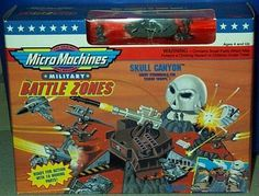 """Skull Canyon Micro Machines Battle Zones Playset by Galoob Micromachines. $45.31. Skull Canyon Enemy Stronghold for Terror Troops!. Micro Machines Military Battle Zones Playset!  Rare Collectible Set for Micro Machines Collectors!. Ready for Action with 10 Moving Parts!. Includes M1A1 Abrams Tank!  The Original Scale Miniatures!. Includes Real-firing Missile Launcher with Rotating Base, Pop-up Skull Bunker """"Explodes"""", Pivoting Gun Station, Pivoting Rocket Laun..."""