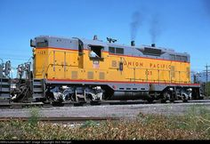 UP GP7 125   Description:  Running in proper long-hood forward fashion (at least for a UP GP7); UP 125 leads five other Geeps on a southbound train through Clearfield UT in Jun 1976. It was retired by UP in 10/77 and sold to PNC; it would end up with Iowa Interstate and Kansas Southwestern.   Photo Date:  6/1/1976  Location:  Clearfield, UT   Author:  Rick Morgan  Categories:    Locomotives:  UP 125(GP7)