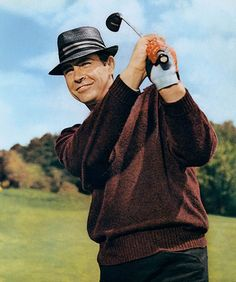 Credit: Allstar Bond on the links (1964) Bond is a gentleman sportsman and Sean Connery looked the part in Goldfinger, taking on the eponymous villain in a round of golf. Connery sports a magnificent wine-coloured V-neck, with the yellow Slazenger panther logo to the fore, much like a young Seve Ballesteros. I like the light grey long-sleeve polo underneath and the grey straw trilby with white and red striped hat ribbon is, of course, a touch of genius.The golf scene introduced…