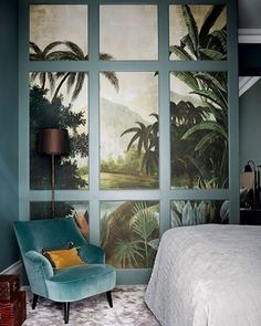 The main bedroom of this house by @thelistbyhouseandgarden member @hackettholland is decorated in dark colours and rich, opulent textures. A corner has been hived off to form a walk-in wardrobe, which is papered with a tropical Ananbô wallpaper and overlaid with a grid of panelling to give it added depth. See the full house at www.houseandgarden.co.uk by @paul_massey #interiors #design #decoration #wardrobe #inspiration #hackettholland