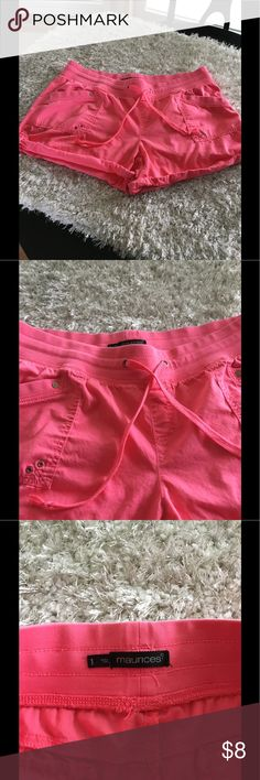 Maurice's Roll Tab Shorts Size 1 (1X) Maurice's roll tab shorts.  Cotton covered elastic waist with drawstring.  Coral pink color. Plus size 1, which is 1X.  Good condition.  Important:   All items are freshly laundered as applicable prior to shipping (new items and shoes excluded).  Not all my items are from pet/smoke free homes.  Price is reduced to reflect this!   Thank you for looking! Maurices Shorts
