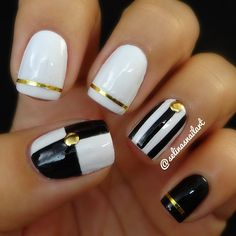 Gorgeous monochrome nail art in checkboard and stripe patterns with gold studding and striped tips by selinasnailart #manicure...x