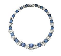 A SAPPHIRE AND DIAMOND NECKLACE, BY HARRY WINSTON  Designed as a series of graduated cushion-shaped sapphires linked with marquise-shaped and brilliant-cut diamond clusters, mounted in platinum, inner circumference 36.5 cm, in black leather Harry Winston case With maker's mark of Jacques Timey and signed Winston for Harry Winston