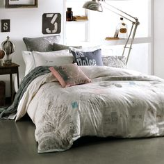 bedroom with vintage maps, views of Ancient Rome and all the romantic icons of the Dolce Vita. Bedding via Linen House