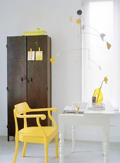 Such a drab, utilitarian desk space. Except for those amazing pops of yellow. And then? Wow!