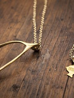wishbone necklace//Bourbon and Boots Jewelry Box, Jewelry Watches, Jewelry Accessories, Fashion Accessories, Dainty Jewelry, Cheap Jewelry, Gold Jewelry, Bourbon And Boots, Wishbone Necklace
