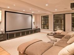 Projection screen + large sectional makes for the perfect rec room.