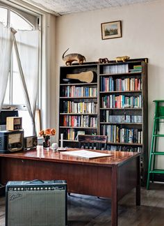 The front of the loft faces Broadway, and you can hear the tour guides' patter through the windows. Michele Varian built this bookshelf for Brad Roberts. (Photo: Bruce Buck for The New York Times)