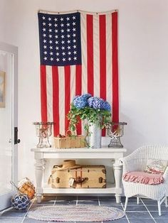 The American flag provides a striking backdrop for a beautiful front porch
