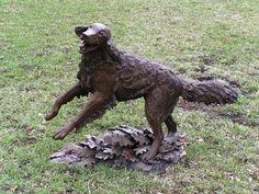 Golden Retriever Running Through Oak Leaves - Alpine, Utah - Dog Statues on Waymarking.com