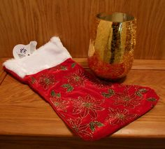 Gold candle holder (candle included) with red velvet Christmas stocking