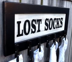 """Lost Socks"" Laundry Sign made with a cabinet door ($5 cabinet door, $0.70 clothes pins) by Cabinet Doors & More.  Great way to reuse an old cabinet / cupboard door!"