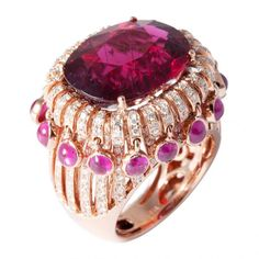 18k one-of-a-kind Bollywood ring in rose gold with cascading white diamonds, dangling ruby and a faceted rubelite centre by Mvee