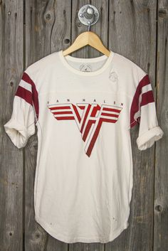 TRUNK LTD brings us the most classic of logos from Van Halen, on a simple yet cute + distressed football tee! · 50% Polyester + 37% Cotton + 13% Rayon · Soft + Lightweight + Distressed Holes · Hand Wa