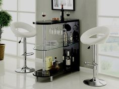 Numbi modern style black lacquered finish and glass mini bar server island table. This bar features a lacquer high gloss finish and chrome accents with a center glass shelf. Some assembly required. Bedroom Designs For Couples, Small Bedroom Designs, Living Room Designs, Mini Bars, Home Bar Sets, Bars For Home, Home Bar Table, Bar Tables, Bar Table Design