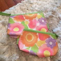 Set of two Clinique makeup/toiletry bags Like new. No marks/stains on outside of either bag. A few VERY MINOR marks on inside of bigger bag. None on inside of smaller. Great for cosmetics, toiletries, or jewelry when traveling. Smoke and pet free home. Clinique Bags Cosmetic Bags & Cases