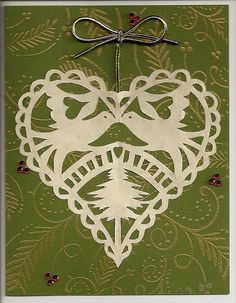 Birds and tree in a heart paper cut