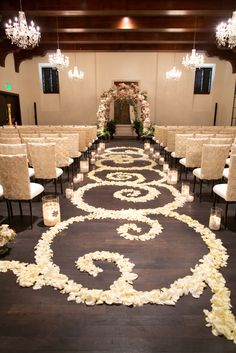 Petals. White chairs. floral arch. Venue: Montelucia Resort & Spa. Floral: Petal Pushers. Design: Outstanding Occasions.