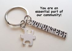 This listing is for 1 keychain. A thank you gift for those that serve the community. The keychain comes on a card that says You are an essential part of our community. The volunteer charm is about 2 inch long. See my other community themed items here: Jewelry Gifts, Unique Jewelry, Team Gifts, Birthstone Necklace, Puzzle Pieces, Autism Awareness, Thank You Gifts, Key Rings, Key Chain