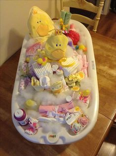 Sweet baby shower gift. The base of the tub is filled with diapers. Way to go Mom! #babyshowergames