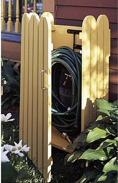 "Garden Hose Hider Woodworking Plan - Product Code DP-00462 | This custom-designed enclosure turns an outdoor eyesore into an attractive feature of your garden. Project measures 36"" tall. #outdoorliving #storage"