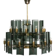 Curved glass and brass chandelier attributed to Fontana Arte   From a unique collection of antique and modern chandeliers and pendants  at http://www.1stdibs.com/furniture/lighting/chandeliers-pendant-lights/