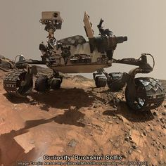 """This low-angle self-portrait of Curiosity on lower Mount Sharp shows the rover at the site from which it reached down to drill into a rock target called """"Buckskin"""" during mission Sol 1065, August 5, 2015."""