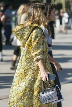 COLD SHOULDER: Staying warm needn't mean covering up - wear your coat open and expose your woolies underneath for a fresh take on cold-weather cool. From bunched-up brocade to the sneak peak of a shoulder, see Vogue's[/i] edit of the best street-style looks for a winter wipe-out.