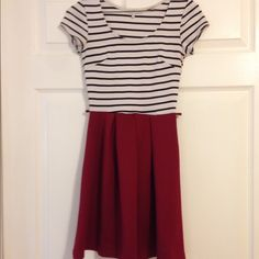 Striped dress White and black striped top with maroon bottom. Very cute dress. Can be worn casual or dressed up. Charlotte Russe Dresses