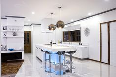 Mal Corby Kitchen. Love the lights and white surfaces.