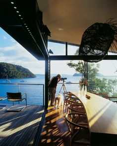 Dougal James-Robertson studies the expansive views that extend all the way to the Barrenjoey headland many miles away with the use of a handy telescope. The sliding glass wall makes the kitchen feel like an outdoor room.