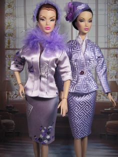 """Integrity Toys """"Victoire"""" dolls modelling Lavender silk suits."""