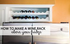 You know that useless cabinet above your fridge? Turn it into a wine rack!
