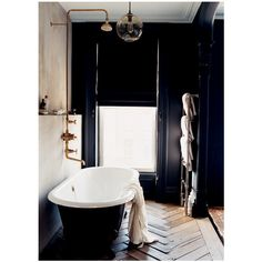 bathrooms - black walls black cast iron clawfoot tub heated towel rack... ❤ liked on Polyvore featuring bathrooms, house, rooms, home and photos