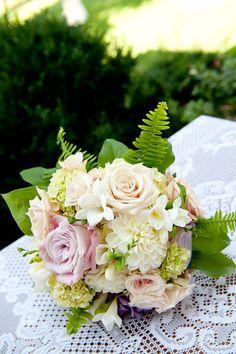 Bridal bouquet by Village Vines Floral and Event Decor - www.villagevinesflorists.com