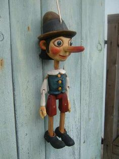 Pinocchio , marionette puppet Each doll marionette is a unique designer work handmade by a Czech artist! The puppet is carved of lime wood using a classical technique. The puppet's body is treated with beeswax and transparent oils, which reveals the structure of the wood and preserves the puppet for a long time. Clothes are made of natural silk patterned by hand.