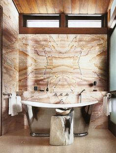 Burma Teak marble works with a lot of wood, offset with stainless Waterworks tub