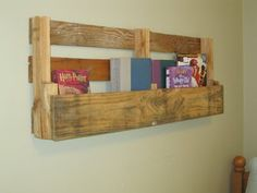pallet > paint (white, most likely) > hang on wall to contain current reading materials (books, magazines ;) )