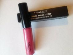 MAC Lip Gloss No 13 Pink Poodle, 0.17 Ounce by M.A.C. $20.99. Shade: Pink Poodle (bright pink). A unique lip gloss available in a wide variety of colours that can create a high gloss, glass-like finish or a subtle sheen. Designed to be worn on its own, over Lip Pencil or Lipstick, Tinted Lipglass is the perfect product for creating shine that lasts. It's pigmented, very shiny and can impart subtle or dramatic colour. It contains Jojoba Oil to help soften and condition the lip...