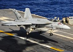 An F/A 18E Super Hornet from the Tomcatters of Strike Fighter Squadron (VFA) 31 lands on the flight deck of the aircraft carrier USS George Washington (CVN 73).