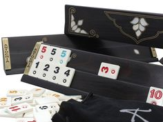 The rummy game set is made of beech wood and inlaid carefully with mother-of-pearl and brass wire. Real mother-of-pearl shaped and inlaid in wooden. You can see the whole beauty and shades of white on Rumicube racks. Beautiful design is completed with brass wire inlay technique. Wooden racks are Backgammon Game, Game Night Parties, Tiles Game, New Homeowner Gift, Wooden Rack, Shades Of White, Fun Activities, Bag Making, House Warming