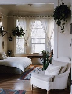 Love this bedroom! The bed the plants the wood floors and the overall decor…