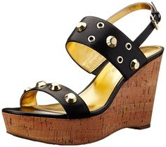 Ivanka Trump Women's Gitty Wedge Sandal >>> Be sure to check out this awesome product.