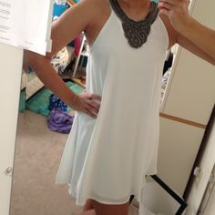 White Formal Dress This gorgeous dress has never been worn and there are no stains. It's the perfect dress to wear to any formal occasion! Dresses Mini