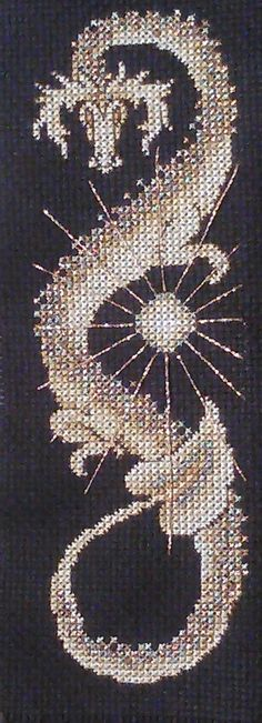 "Sun Dragon: ""It called for Kreinik #4 very fine braid, which I'd never used before; I was pleasantly surprised by how easy it was to work with."""